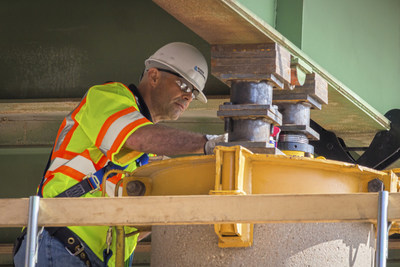 Mike Carroll, an associate bridge engineer at Burns & McDonnell, inspects anchor bolts before a new bolster is placed in position to support a bridge being lifted to increase vehicle clearance along the Interstate 35 section of the Kansas Turnpike.