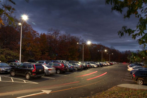 Evolucia Aimed Optics LED cobra head parking lights brighten the upper and lower campus parking lots at Bentley University in Waltham, MA.  (PRNewsFoto/Evolucia, Inc.)