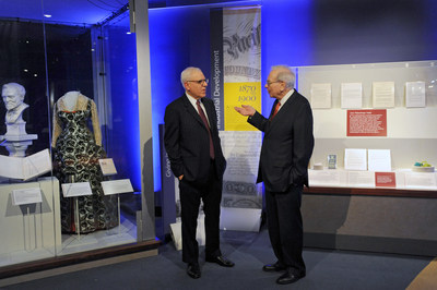 """David Rubenstein, co-CEO, The Carlyle Group and Chair, Smithsonian Board of Regents and Warren Buffett, chairman and CEO, Berkshire Hathaway Inc. preview the """"Giving in America' display at the National Museum of American History. The cases, which open to the public Dec. 1, examine philanthropy in two American eras, the Gilded Age and today."""
