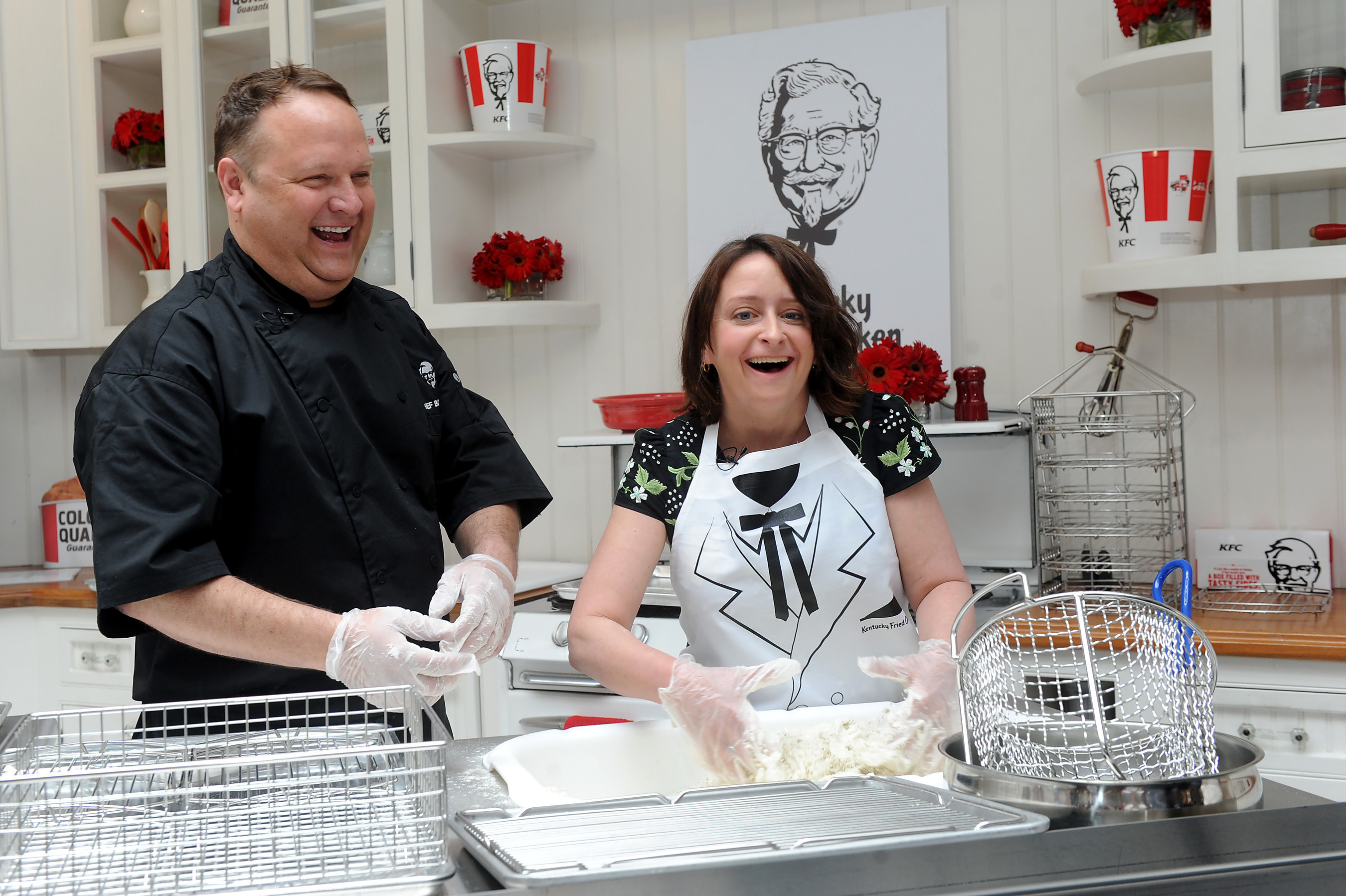 KFC U.S. Head Chef, Bob Das, teaches actress and comedienne, Rachel Dratch, how to make KFC Original Recipe fried chicken at the KFC Re-Colonelization event on Monday, April 4, 2016 in New York City. (Diane Bondareff/AP Images for KFC)