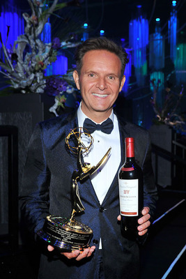 Executive Producer, Mark Burnett posing with his Emmy and etched bottle of Beaulieu Vineyard Georges de Latour. He won his Emmy for Outstanding Reality Competition Series, The Voice.  (PRNewsFoto/Beaulieu Vineyard)