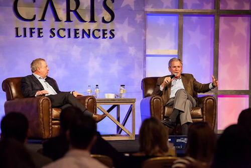 Former President George W. Bush and Caris Life Sciences Chairman and CEO David D. Halbert at the company's annual sales meeting.  (PRNewsFoto/Caris Life Sciences)