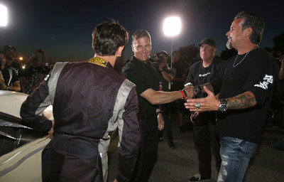 "Tim Kuniskis, President and CEO of Dodge and SRT, FCA US, (second from left) congratulates Richard Rawlings of Gas Monkey Garage after his custom 1967 Dodge Dart powered by a 707-horsepower Dodge SRT Hellcat engine won a drag race against Roadkill's ""General Mayhem"" 1968 Dodge Charger, also upfitted with the Hellcat engine at the first ever ""Roadkill Nights Powered by Dodge"" Wednesday, Aug. 12. The Dart took ultimate bragging rights with a 5.81 second 1/8 mile time..."