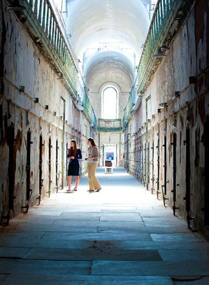 "Philadelphia, PA - Admission to Eastern State Penitentiary includes ""The Voices of Eastern State"" Audio Tour. This rich, stereo soundscape mixes dozens of voices, including three former wardens and 25 former guards and inmates - creating an intimate walking tour of Eastern State's cellblocks and yards. More than two hours of content, with individual stops including Death Row, the solitary exercise yards, the restored synagogue and Al Capone's Cell. Narrated by actor Steve Buscemi (Boardwalk Empire, Fargo, Armageddon). Source: Eastern State Penitentiary. Photo: Jeff Fusco"