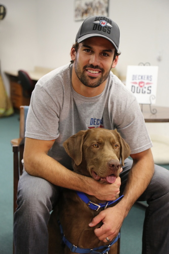 "NY Jets' Eric Decker and ""Deckers Dogs"" Team with Veterinary Pet Insurance (VPI) to Celebrate Pet Parent's Day. For every new quote generated at petparentsday.com through Memorial Day (May 26), VPI will donate $5 to Deckers Dogs to help fund the rescue, care and training of service dogs for our military veterans returning home with disabilities. (PRNewsFoto/Deckers Dogs)"