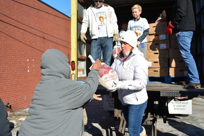 Edwardsville and Chicago Injury Lawyers, TorHoerman Law, give away turkeys to needy families in Madison County, Illinois.