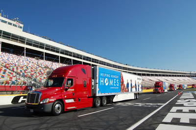 Eight Smithfield Helping Hungry Homes trucks, each carrying over 40,000 pounds of protein, depart Charlotte Motor Speedway to deliver the 3 million hot dogs to food banks across the country.  (PRNewsFoto/Smithfield)