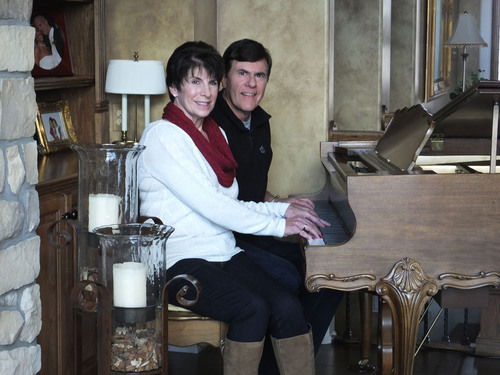 Former Naperville, IL residents John and Dee Rottluff play the piano in their Tellico Village home, an ...