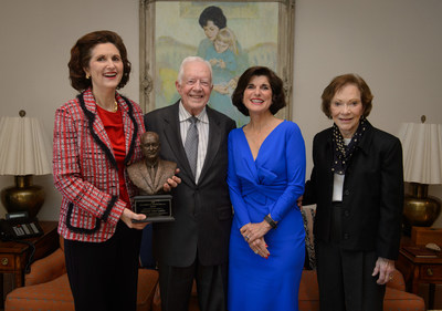 L-R:  Lynda Johnson Robb, President Jimmy Carter, Luci Baines Johnson, Rosalynn CarterPhoto by Michael A. Schwarz
