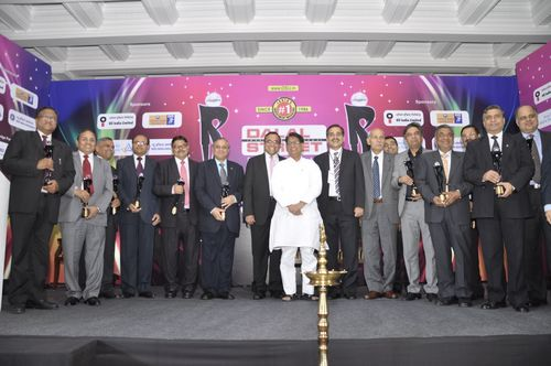 Mr. Ajit Singh, Union Minister of Civil Aviation and Mr. Sanjay Padode, Managing Director of DSIJ Pvt. Ltd. with the winners at 4th DSIJ PSU Awards 2012 (PRNewsFoto/DSIJ Pvt. Ltd)