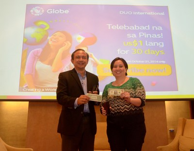 Leading the announcement for Globe Duo International $1 promo are Globe Executive Vice President and Chief Operations Officer Gil Genio and Globe International Business Group Marketing Director Carmina Villo.