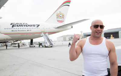 Vin Diesel welcomes Etihad Airways Flight 171 as it arrives at LAX from Abu Dhabi on the afternoon of March 18. The Fast & Furious 777 airliner's arrival kicks off the global junket and world premiere of Furious 7. (Credit: Alex J. Berliner)