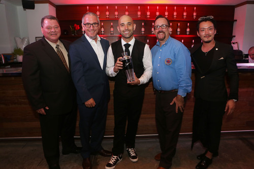 Nick Nistico, winner of the 2012/2013 USBG Legacy Cocktail Showcase, accepts his title from the panel of ...