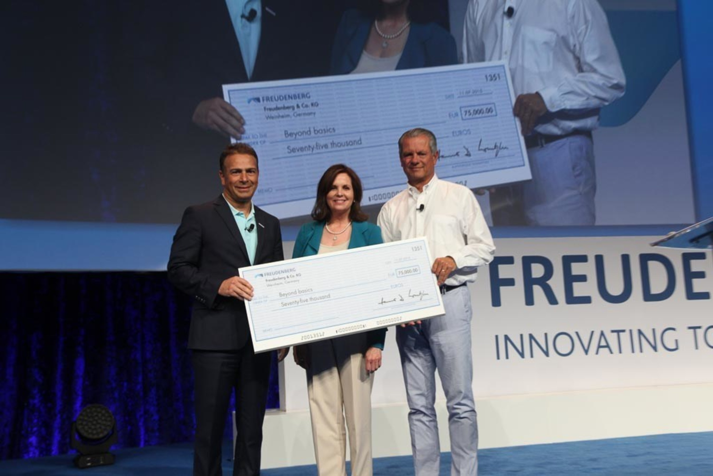Pamela Good, president and executive director of Beyond Basics with Dr. Mohsen Sohi, CEO and Hanno D. Wentzler, member of the Executive Council of the Freudenberg Group