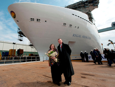 "Regal Princess met the water for the first time in a traditional shipyard ceremony today featuring ""Madrina"" Carolyn Spencer Brown with Princess Executive Vice President Rai Caluori.  (PRNewsFoto/Princess Cruises)"