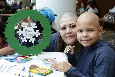 Just in time for World Kindness Day, Hilda Ramirez and her son Adan receive ornaments personalized just for them by hand painters from leading e-commerce gifting retailer Personal Creations at Ann & Robert H. Lurie Children's Hospital of Chicago on Wednesday, Nov. 11.  Photo by Jean Marc Giboux/AP Images for Personal Creations.