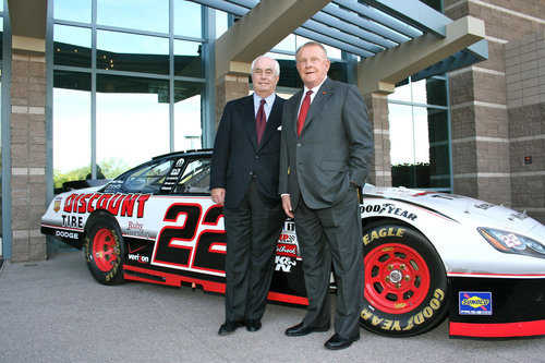 Roger Penske (left) and Bruce T. Halle (right), founder and chairman of Discount Tire, celebrate their 2010 ...
