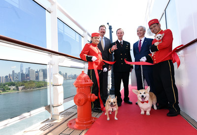 Richard Meadows, center left, President, Cunard, North America, Captain Christopher Wells, center, and David Noyes, center right, CEO, Cunard, joined by Cunard Kennel Masters, cut a ribbon to unveil the remastered kennels on the Queen Mary 2, the only passenger liner to carry pets. (Diane Bondareff/AP Images for Cunard)