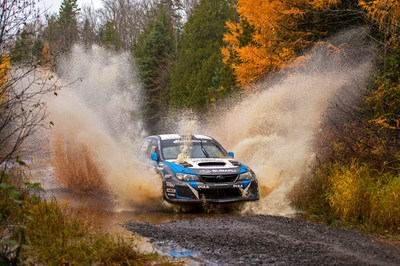 David Higgins charges his WRX STI through deep water at Lake Superior Performance Rally 2014.