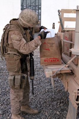 Operation Feeding Freedom VIII: Outback Steakhouse and Carrabba's Italian Grill feed troops overseas. U.S. Marine picks up an Outback To Go order at Camp Dwyer in Afghanistan.