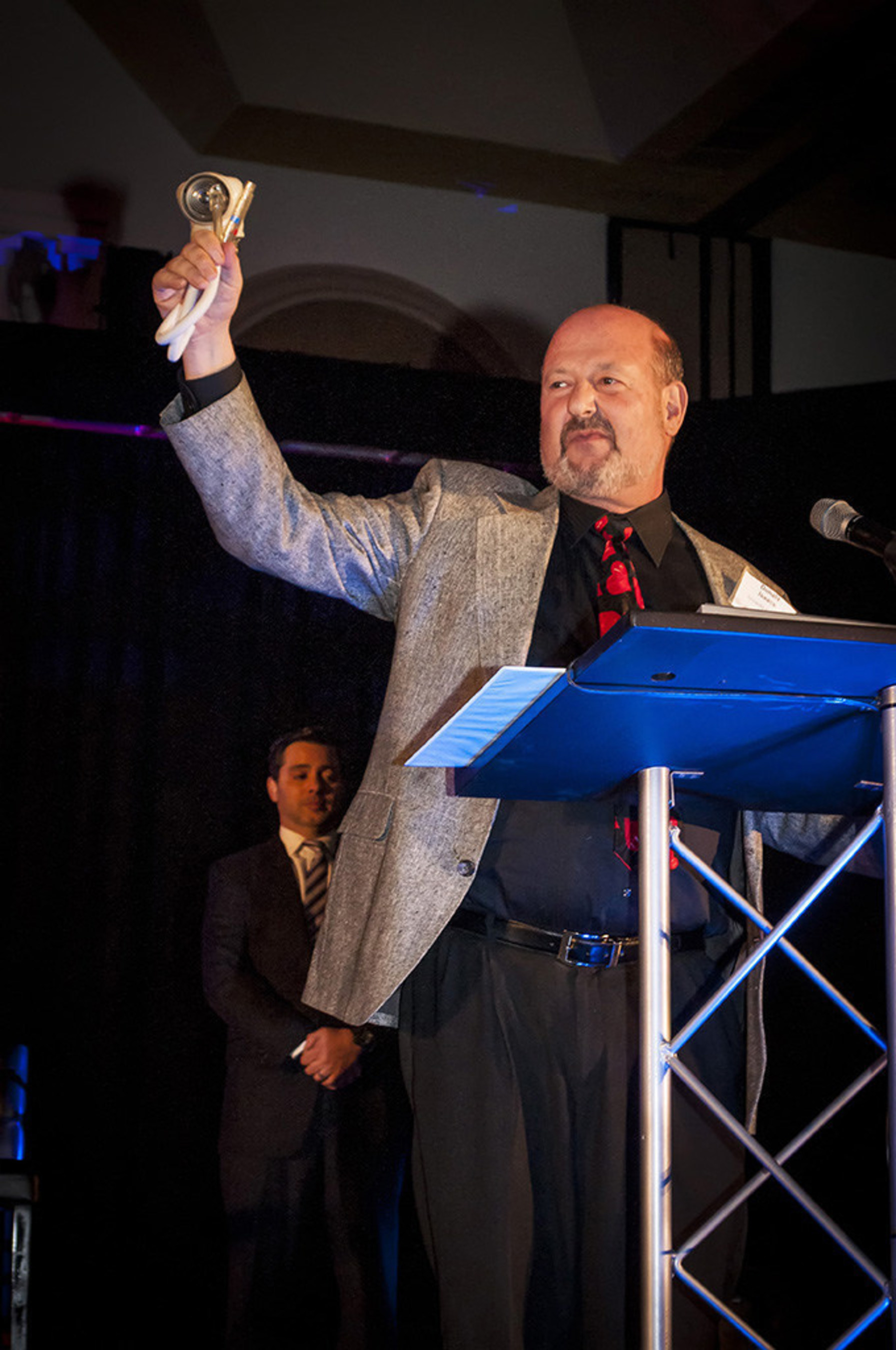 Don Isaacs shows the 2015 HealthCare Leadership Awards audience the 50cc SynCardia Total Artificial Heart that is in a clinical study.