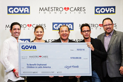Goya Foods Donates $150,000 to Marc Anthony's Maestro Cares Foundation to help build a new orphanage in Barranquilla, Colombia.  Bob Unanue, President of Goya and Frank Unanue, President of Goya Florida present Marc Anthony and Henry Cardenas, Co-Founders of Maestro Cares with the check in Miami, Florida.