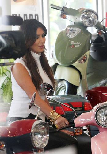 Kim Kardashian Visits Genuine Scooters's Miami Dealership