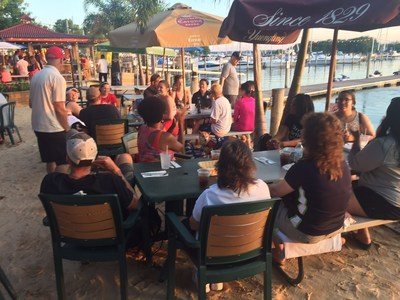 Wounded warriors recently enjoyed socializing during a monster stand-up paddleboarding competition at a program gathering with Wounded Warrior Project in Middle River, Maryland.