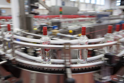 Smirnoff vodka flies down the line at Diageo's newly-expanded high-speed Plainfield, IL bottling facility.  The site is Diageo's largest facility in North America, producing the equivalent of 372 million 750ml bottles per year.  (PRNewsFoto/Diageo)