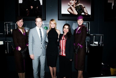 (From left to right, flanked by Etihad Airways cabin crew), Patrick Pierce, Vice President of Sponsorships - Etihad Airways; Supermodel Amber Valletta; and Amina Taher, Head of Corporate Communications - Etihad Airways celebrate the opening of the Jimmy Choo VIP Lounge hosted by Etihad and WME | IMG at Skylight at Moynihan Station.