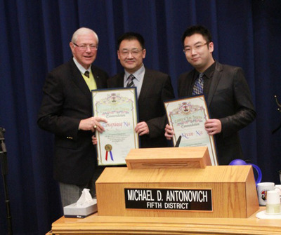 Presentation of the Scroll Award to Dr. Rongxiang Xu and Kevin Xu by Supervisor Michael Antonovich.  (PRNewsFoto/Dr. Rongxiang Xu)