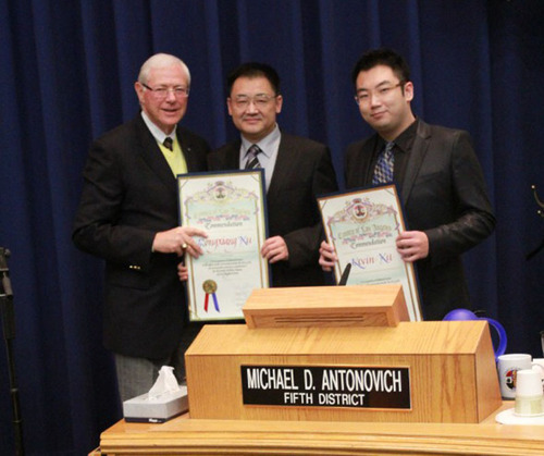Presentation of the Scroll Award to Dr. Rongxiang Xu and Kevin Xu by Supervisor Michael Antonovich. ...