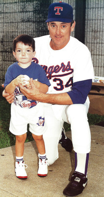 1992: Nolan Ryan and Ryan Dant exchange autographs. Considered terminal as a 4-year-old with a rare genetic disorder that affected only 1000 people globally, Dant, now 22, will watch his beloved Texas Rangers take on the San Francisco Giants in Game 3 of the World Series Saturday evening.  (PRNewsFoto/Kakkis EveryLife Foundation)