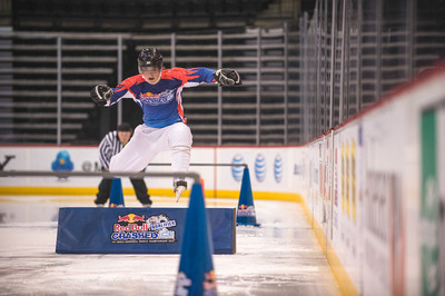 An athlete jumps over an obstacle at the final Red Bull Crashed Ice Qualifier in Saint Paul. 100 national athletes will battle against 100 international athletes when the Red Bull Crashed Ice World Championship Tour series makes its way to Saint Paul January 24-26.  (PRNewsFoto/Red Bull)