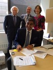 Sezgin Baran Korkmaz, founder and CEO of SBK Holding, signs the agreement with Relief International (L) Paul Levengood, Relief International board chairperson (M) Cenk Aydin, Managing Director and Partner, MENA at Armstrong Investment Managers (R) Nancy Wilson, president and CEO, Relief International
