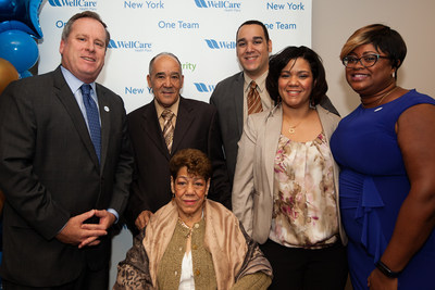 Maria Marte, pictured in the wheelchair above, is surrounded by her family and WellCare of New York President John J. Burke (far left) and WellCare of New York care manager Trisha Simon (far right). Mrs. Marte is a WellCare of New York member who was assisted by the company's field-based care management program, which is designed to provide personalized care to high-risk members to help them improve and maintain their health.