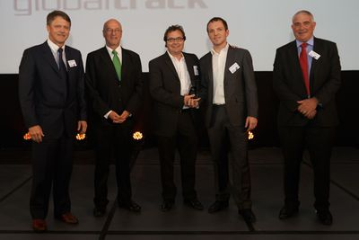 CEO of GlobalTrack, Pieter Smits, accepting the award for Excellence in Management of Systems.