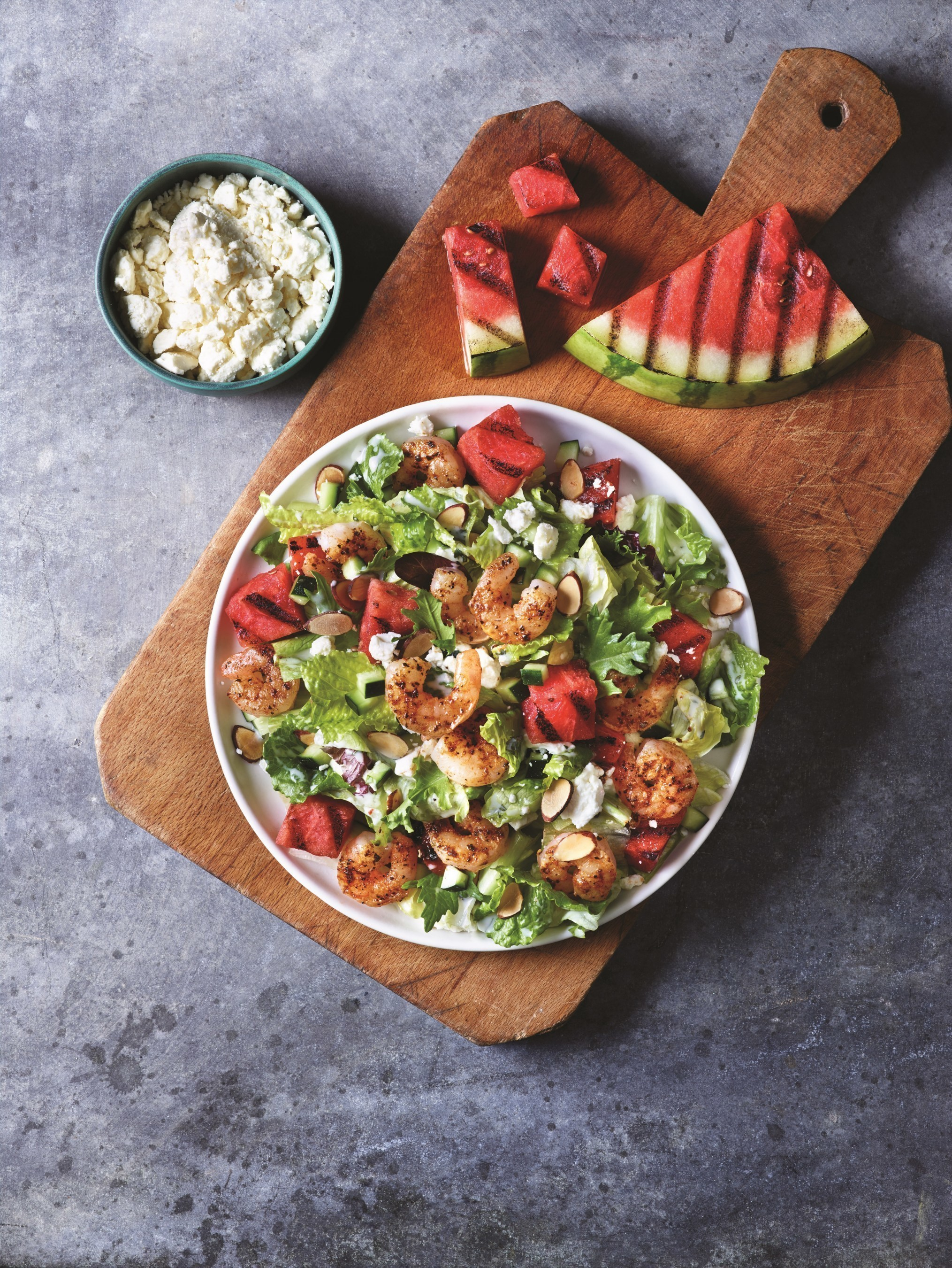 Applebee's NEW Grilled Watermelon and Spicy Shrimp Salad is made with mixed greens, cucumbers, feta, almonds and house-made creamy mint-Greek yogurt dressing.