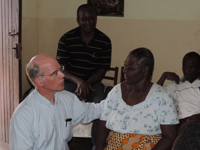 During a trip to Tanzania in 2014, Susquehanna Health Home Care & Hospice Medical Director, Dr. Nesbitt was able to make home visits.  He is pictured here talking with a palliative care patient who suffered from diabetes and hypertension.