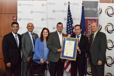 New York State Department of Health, Dr. Howard Zucker delivers a proclamation from the Governor's office with Michael Klipper and James J. Hanson of Voices Against Brain Cancer