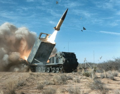 A Lockheed Martin M270A1 launcher fires an ATACMS long-range missile during a 2009 test.