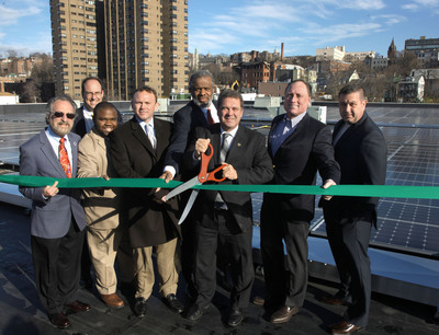 Pictured (L to R) at unveiling of new rooftop solar power generation plant at i.Park Hudson in Yonkers, NY are: Yonkers Councilman Michael Sabatino, Council President Chuck Lesnick, Councilman Christopher Johnson, Michael Hastings, CEO of Half Moon Ventures (solar plant designer/builder), developer Erik J. Rucker, Yonkers Mayor Mike Spano, i.Park Hudson owner Joe Cotter, and Ray Melarczik of Tancora, Inc. (electrical sub-contractor).  (PRNewsFoto/Half Moon Ventures, LLC)