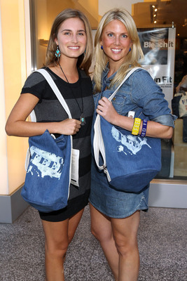 Gap has joined forces with FEED Projects founders Lauren Bush and Ellen Gustafson [pictured here with the FEED USA Denim Bucket Bag, $39.50], to introduce FEED USA, a new initiative and exclusive bag collection designed to bridge the gap in America's school lunch programs. Gap will donate $5 for every FEED USA bag sold to help improve food and nutrition education. Shoppers will get a special code to select where their donation will go based on teacher-led requests.  (PRNewsFoto/GAP Inc.)