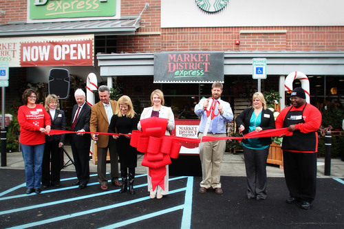 Giant Eagle CEO Laura Karet and Market District Express Store Leader Anna Card are joined by store Team Members and local officals at the ribbon cutting ceremony.  (PRNewsFoto/Giant Eagle)