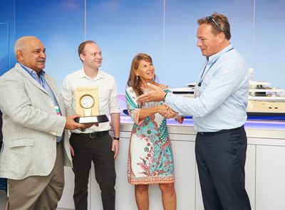 """Oceanco's recent launch, M/Y NIRVANA, has won the 2013 prestigious Robb Report Award for the """"Best of the Best"""" in the Megayachts category. On September 25th, the first day of the Monaco Yacht Show, Robb Report's Worldwide Marine Director, Jody Dunowitz, and Associate Editor, Bailey Barnard, presented the award to Oceanco Chairman, Dr Mohammed Al Barwani, and CEO Marcel Onkenhout. (PRNewsFoto/Oceanco)"""