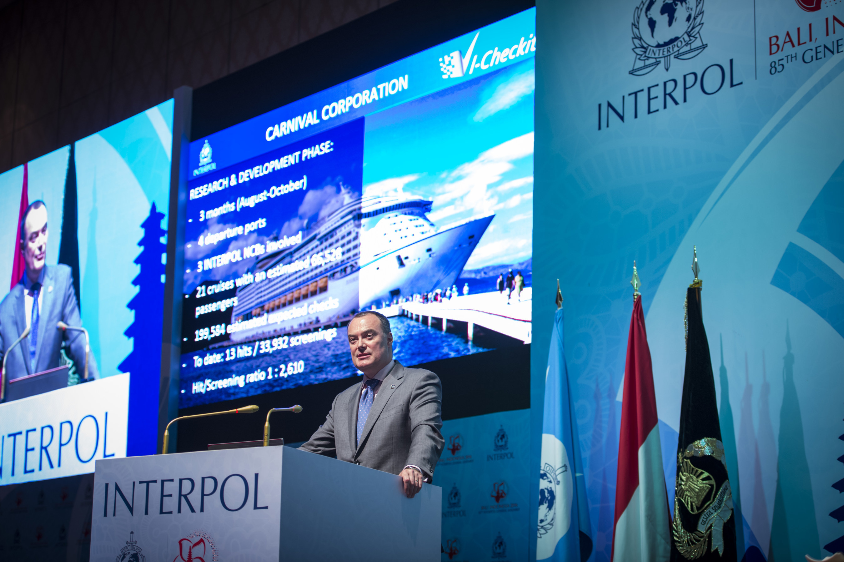Mick O'Connell, director of operational support and analysis for INTERPOL, presents at INTERPOL's General Assembly where Carnival Corporation was announced as the first maritime company to partner with the organization for advanced security screening across its global operations. Carnival Corporation received approval at the Assembly to integrate its global passenger check-in process with INTERPOL's I-Checkit system.
