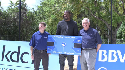 NBA All-Star Kevin Durant poses with BBVA Compass Texas Regional Executive Jeff Dudderar and BBVA Compass Austin CEO Joe Petet at the site of IDEA Rundberg Public School's new basketball court.
