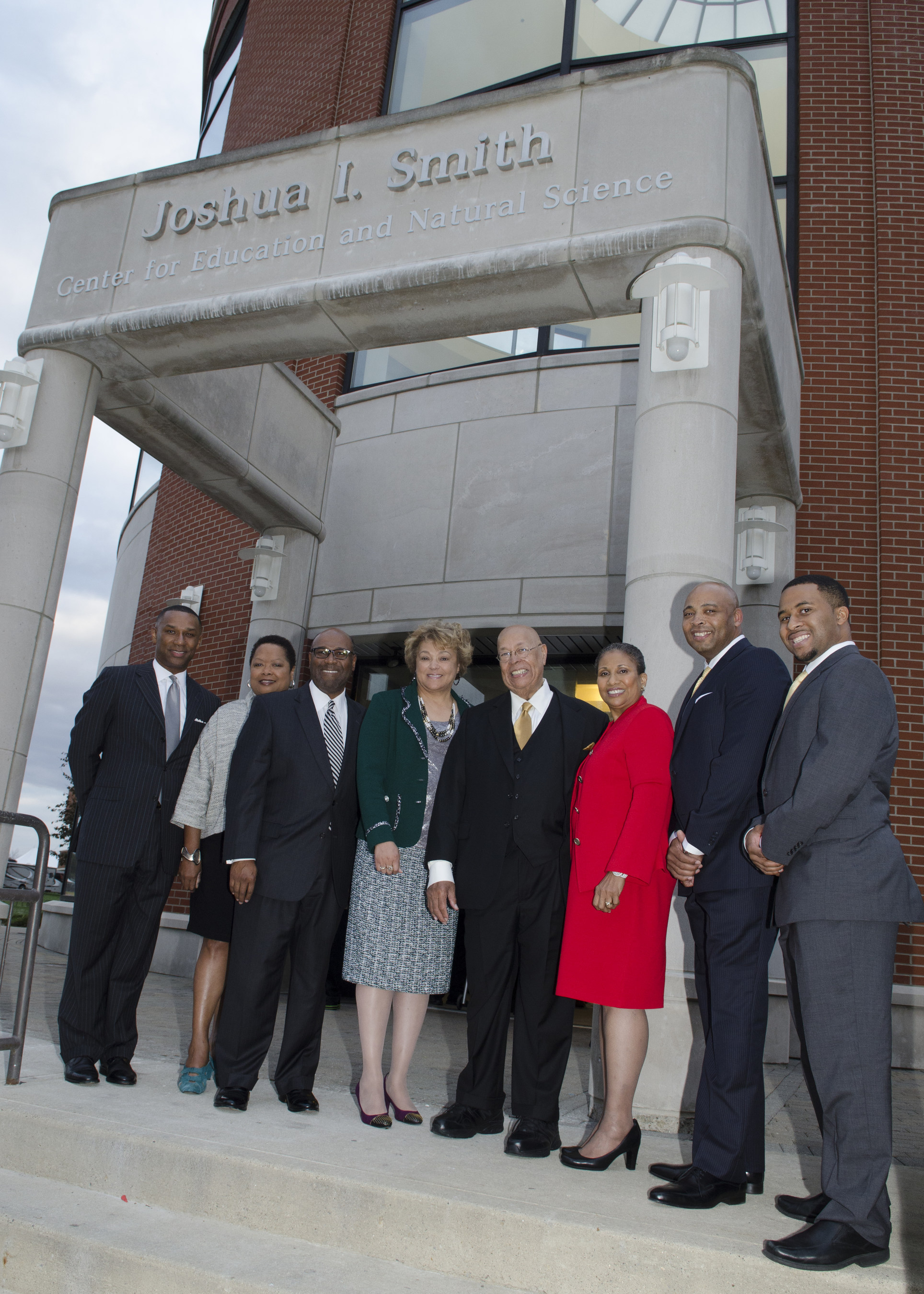 Businessman and philanthropist Dr. Joshua I. Smith is joined at the building renaming ceremony by Central State University president Dr. Cynthia Jackson-Hammond, his wife Reverend Jacqueline Smith, Esquire and executives from Caterpillar, FedEx and Disney.