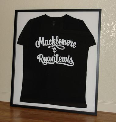 Macklemore & Ryan Lewis autographed shirt.  (PRNewsFoto/BandShirtArchive.com)