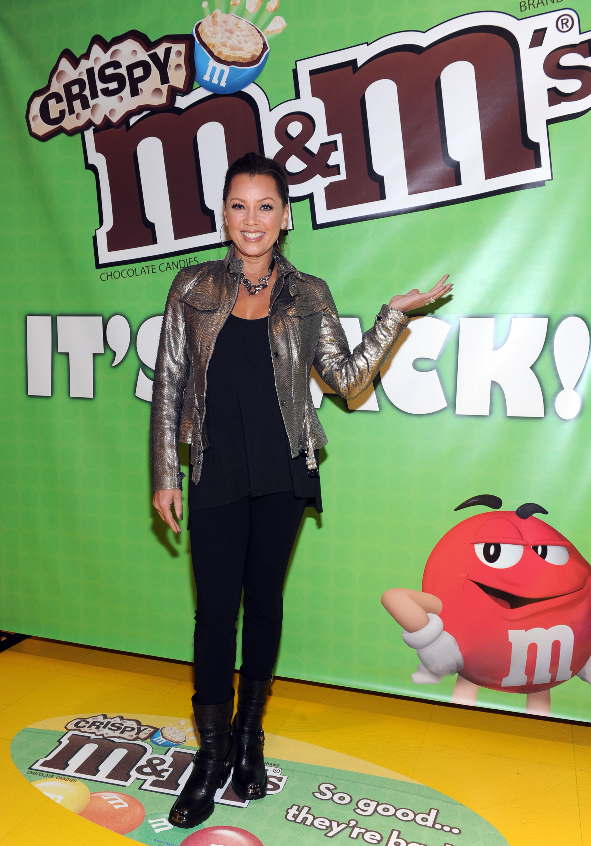 (December 9, 2014) Vanessa Williams, the multi-talented entertainer and voice behind M&M'S(R) Brand spokescandy Ms. Brown, welcomes the first batch of M&M'S(R) Crispy to M&M'S World(R) in Times Square. The product will begin returning to store shelves nationwide this week after a 10-year hiatus, thanks to a vocal fan base who pleaded for its return. (Photo by Diane Bondareff for Mars Chocolate North America)
